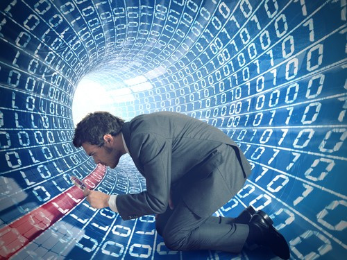 Man in digital tunnel with numbers floating around him